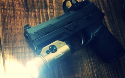 A Marine's tips for carrying pistols with reflex sights: flashlights